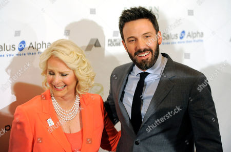 Honoree Ben Affleck, right, shares a laugh with Gala Chair Cindy Hensley McCain at the Cinema For Peace Foundation's 2013 Gala for Humanity at the Beverly Hills Hotel, in Beverly Hills, Calif