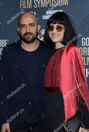 Director Shlomi Elkabetz and actress and director Ronit Elkabetz arrive at Golden Globes Foreign Language Symposium at Egyptian Theatre, in Hollywood, California