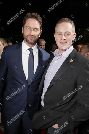 Stock Picture of Gerard Butler and Peter Schlessel, Chief Executive Officer, Focus Features, seen at Grammercy Pictures Present the Los Angeles Premiere of 'London Has Fallen' at ArcLight Hollywood, in Hollywood, CA