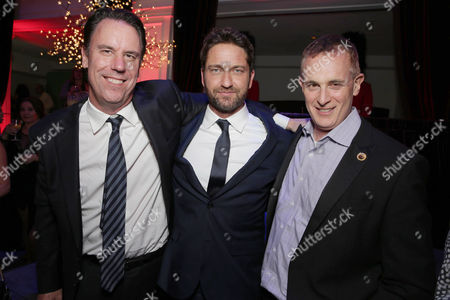 Stock Photo of Mark Gill, President of Millennium Films, Gerard Butler and Peter Schlessel, Chief Executive Officer, Focus Features, seen at Grammercy Pictures Present the Los Angeles Premiere of 'London Has Fallen' at ArcLight Hollywood, in Hollywood, CA