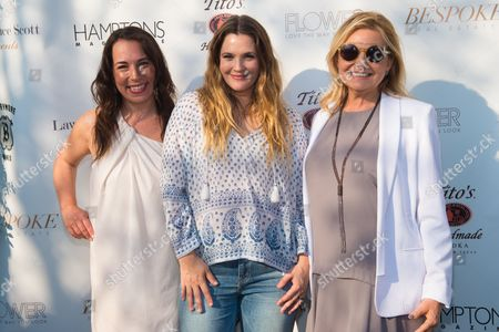 Samantha Yanks, from left, Drew Barrymore, middle, and Debra Halpert attend Hamptons Magazine Memorial Day Soiree at a private estate in Sagaponack, in New York