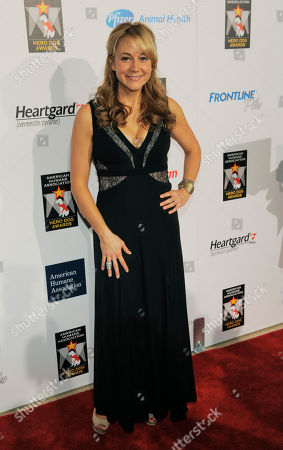 Actress Megyn Price poses at the Hero Dog Awards at the Beverly Hilton Hotel, in Beverly Hills, Calif. The event honored America's most courageous canines