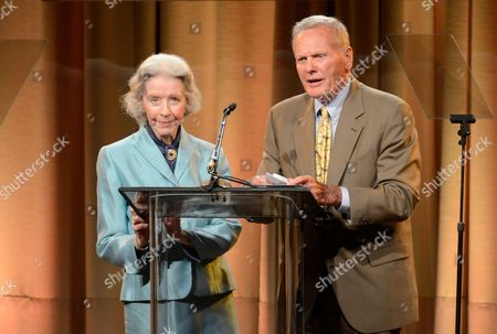 Marsha Hunt, left, and Tab Hunter speak on stage at the Hollywood Foreign Press Association Luncheon at the Beverly Hilton Hotel, in Beverly Hills, Calif