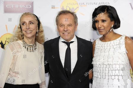 From left, Franca Sozzani, Wolfgang Puck, and Gelila Puck arrive at the inaugural Dream for Future Africa Foundation Gala at Spago on in Beverly Hills, Calif