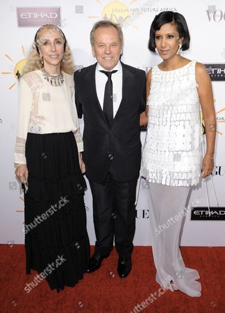Stock Image of From left, Franca Sozzani, Wolfgang Puck, and Gelila Puck arrive at the inaugural Dream for Future Africa Foundation Gala at Spago on in Beverly Hills, Calif
