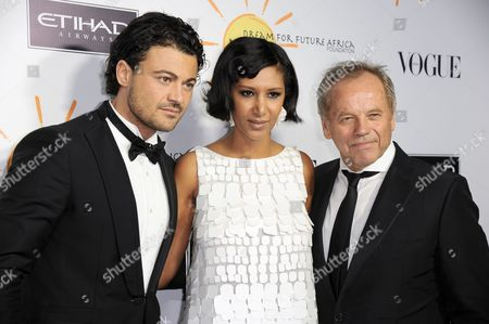 From left, Vittorio Grigolo, Wolfgang Puck, and Gelila Puck arrive at the inaugural Dream for Future Africa Foundation Gala at Spago on in Beverly Hills, Calif