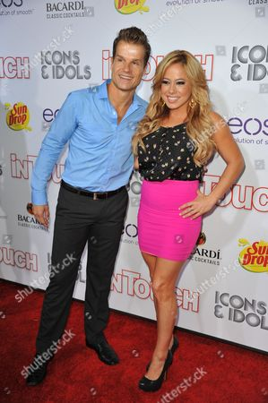 Louis van Amstel, left and Sabrina Bryan attend InTouch Icons and Idols at the Chateau Marmont, in West Hollywood, Calif