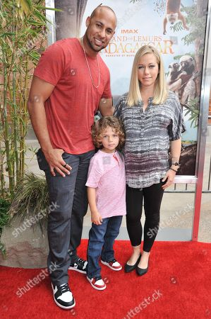 Stock Photo of From left, Hank Baskett, Hank Baskett IV, and Kendra Wilkinson arrive at the LA Premiere - Island of Lemurs: Madagascar, in Los Angeles