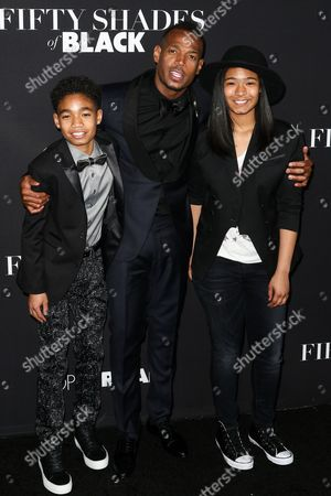 """Stock Picture of Shawn Howell Wayans, from left, Marlon Wayans and Amai Zackary Wayans attend the LA Premiere of """"50 Shades of Black"""" held at Regal L.A. Live, in Los Angeles"""