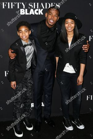 """Shawn Howell Wayans, from left, Marlon Wayans and Amai Zackary Wayans attend the LA Premiere of """"50 Shades of Black"""" held at Regal L.A. Live, in Los Angeles"""