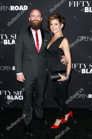 """Michael Tiddes, left, and Kelly Tiddes attend the LA Premiere of """"50 Shades of Black"""" held at Regal L.A. Live, in Los Angeles"""