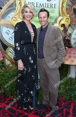 """Jenna Elfman, left, and Bodhi Elfman arrive at the premiere of """"Alice Through the Looking Glass"""" at the El Capitan Theatre, in Los Angeles"""
