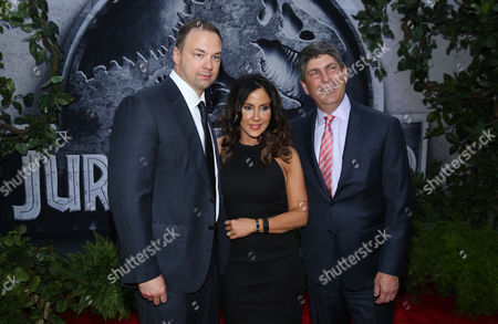 """Executive producer Thomas Tull, from left, Alba Tull and Jeff Shell, chairman of Universal Filmed Entertainment Group, arrive at the Los Angeles premiere of """"Jurassic World"""" at the Dolby Theatre on"""