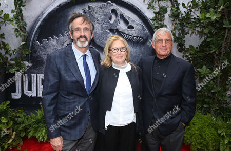 "Producer Patrick Crowley, from left, Cathleen Summers and Ron Meyer, vice chairman of NBCUniversal, arrive at the Los Angeles premiere of ""Jurassic World"" at the Dolby Theatre on"