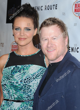 """Miracle Laurie, at left, and Christopher May arrives on the red carpet for the premiere of """"Scenic Route"""" at the Chinese 6 Theater on in Los Angeles"""