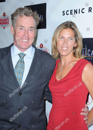 """John McGinley, at left, and his wife, Nicole, arrive on the red carpet for the premiere of """"Scenic Route"""" at the Chinese 6 Theater on in Los Angeles"""