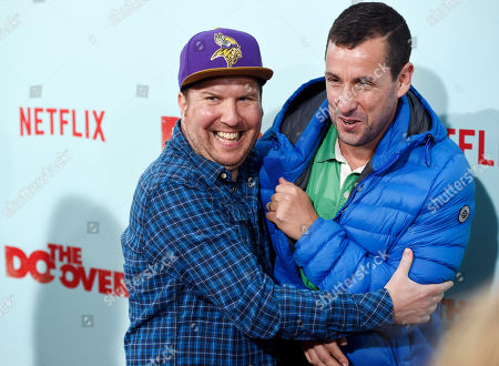 """Nick Swardson, left, a cast member in """"The Do-Over,"""" embraces fellow cast member Adam Sandler at the premiere of the film at the Regal LA Live theaters, in Los Angeles"""