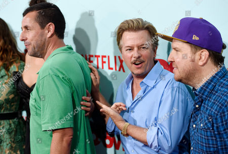 """David Spade, center, a cast member in """"The Do-Over,"""" gestures to fellow cast member Adam Sandler, left, as cast member Nick Swardson looks on at the premiere of the film at the Regal LA Live theaters, in Los Angeles"""