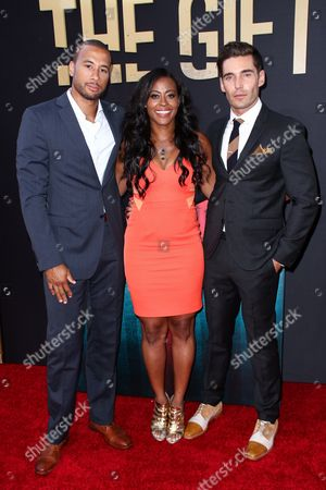 """Nick Hounslow, from left, Nichelle Hines and Aaron Hines arrive at the LA Premiere of """"The Gift"""" held at Regal Cinemas L.A. Live, in Los Angeles"""