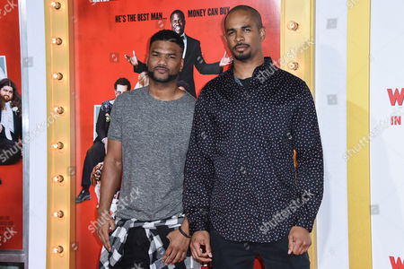 Damien Dante Wayans, left and Damon Wayans Jr. arrive at the LA Premiere Of The Wedding Ringer at the TLC Chinese Theatre, in Los Angeles, CA