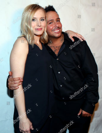 """Actors Kristen Bell, left, and Francis Capra pose together at the after party for the premiere of """"Veronica Mars"""", in Los Angeles"""