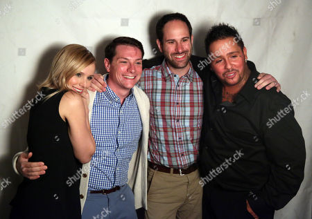 """Actors Kristen Bell, left, and Francis Capra, right, take pictures with Kickstarter backers at the after party for the premiere of """"Veronica Mars"""", in Los Angeles"""