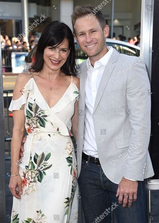 """Stock Image of Perrey Reeves, left, and Aaron Endress-Fox arrive at the Los Angeles premiere of """"War Dogs"""" at the TCL Chinese Theatre on"""