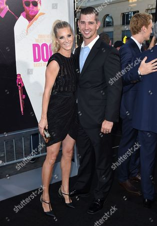 """Heather Morris, left, and Taylor Hubbell arrive at the Los Angeles premiere of """"War Dogs"""" at the TCL Chinese Theatre on"""