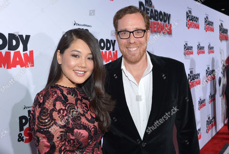 """Director Rob Minkoff (R) and Crystal Kung attend' the LA Premiere of """"Mr. Peabody & Sherman"""" on in Los Angeles"""