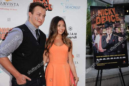 "Noah Munck, left, anf Cristine Prosperi arrive at the LA premiere of ""Nicky Deuce"" at the ArcLight Hollywood on in Los Angeles"