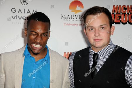 """Cassius Crieghtney, left, and Noah Munck arrive at the LA premiere of """"Nicky Deuce"""" at the ArcLight Hollywood on in Los Angeles"""