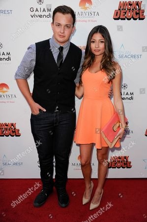 """Noah Munck, left, anf Cristine Prosperi arrive at the LA premiere of """"Nicky Deuce"""" at the ArcLight Hollywood on in Los Angeles"""