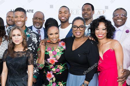"""Stock Picture of Deji LaRay, fron left, Benjamin Patterson, Desiree Ross, Gregalan Williams, Lynn Whitfield, Tye White, Oprah Winfrey, Lamman Rucker, Terry Abney, and Keith David arrive at the season one premiere of """"Greenleaf"""" at The Lot, in West Hollywood, Calif"""