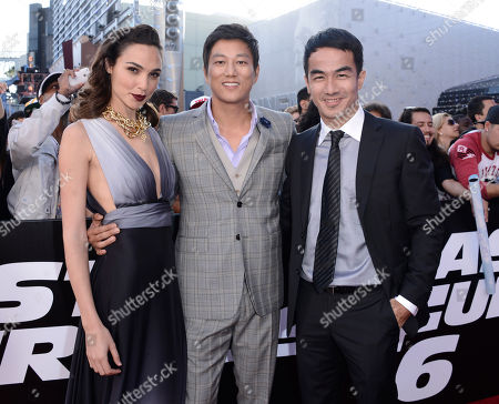"Stock Picture of Actress Gal Gadot, left, actor Sung Kang, center, and actor Joe Taslim arrive at the LA Premiere of the ""Fast & Furious 6"" at the Gibson Amphitheatre on in Universal City, Calif"