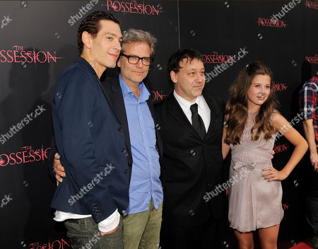 "Ole Bornedal, second from left, director of ""The Possession,"" poses with, from left, cast member Matisyahu, producer Sam Raimi and cast member Natasha Calis at the premiere of the film at Arclight Cinemas, in Los Angeles"
