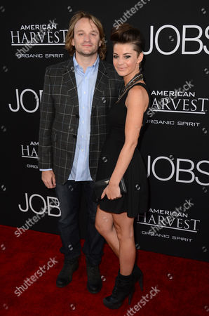 """From left, Lenny Jacobson and guest arrive at the special screening of """"Jobs"""" at the Regal Cinemas L.A. Live, in Los Angeles"""
