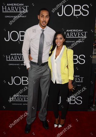 """From left, Ryan Hollins and Janice Hollins arrive at the special screening of """"Jobs"""" at the Regal Cinemas L.A. Live, in Los Angeles"""