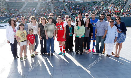 Donors and donees with family and Mia Hamm at the LAFEST LA Film and Entertainment Soccer Tournament, on in Carson, California