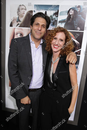President, Motion Picture Group for MGM Jonathan Glickman and Author Gayle Forman seen at the Los Angeles World Premiere of New Line Cinema's and Metro-Goldwyn-Mayer Pictures' 'If I Stay' held at TCL Chinese Theatre, in Hollywood
