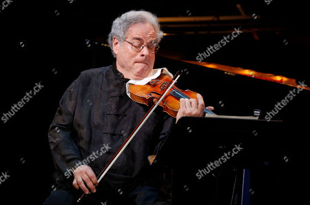 Itzhak Perlman performs during A Tribute to Marvin Hamlisch, a memorial concert, at The Juilliard School's Peter Jay Sharp Theater, in New York