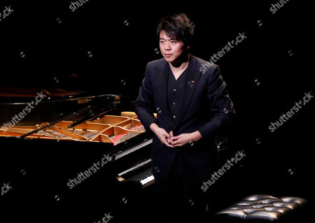 Lang Lang performs during A Tribute to Marvin Hamlisch, a memorial concert, at The Juilliard School's Peter Jay Sharp Theater, in New York