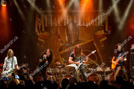 Rex Brown, of Pantera, Mark Osegueda, of Death Angel, Chris Broderick, of Megadeth, and Alex Skolnick, of Testament, perform on stage during the Metal Allegiance concert at the House of Blues, in Anaheim, Calif