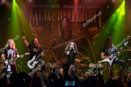David Ellefson, of Megadeth, Andreas Kisser, of Sepultura, Mark Osegueda, of Death Angel, and Chris Broderick, of Megadeth, perform on stage during the Metal Allegiance concert at the House of Blues, in Anaheim, Calif