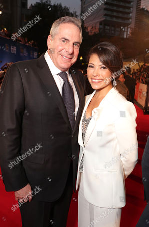 """Executive Producer Roger Birnbaum and Karla Jensen seen at MGM and Columbia Pictures' world premiere and opening night screening of """"The Magnificent Seven"""" at the 2016 Toronto International Film Festival, in Toronto, CAN"""