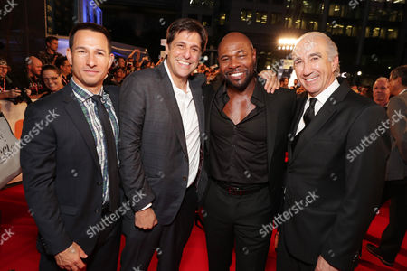 """Adam Rosenberg, MGM Executive Vice President of Production, Jonathan Glickman, President for Motion Picture Group, Director Antoine Fuqua and Gary Barber, MGM Chairman and Chief Executive Officer, seen at MGM and Columbia Pictures' world premiere and opening night screening of """"The Magnificent Seven"""" at the 2016 Toronto International Film Festival, in Toronto, CAN"""