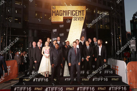 """Richard Wenk, Todd Black, Haley Bennett, Luke Grimes, Martin Sensmeier, Manuel Garcia-Rulfo, Denzel Washington, Director Antoine Fuqua, Chris Pratt, Ethan Hawke, Vincent D'Onofrio, Byung-hun Lee and Peter Sarsgaard seen at MGM and Columbia Pictures' world premiere and opening night screening of """"The Magnificent Seven"""" at the 2016 Toronto International Film Festival, in Toronto, CAN"""
