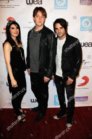 From left, Emma Anzai, Shimon Moore and Mark Goodwin arrive at the NARM Music Biz 2013 Dinner Party at the Hyatt Regency Century City Plaza Hotel on in Century City, Calif
