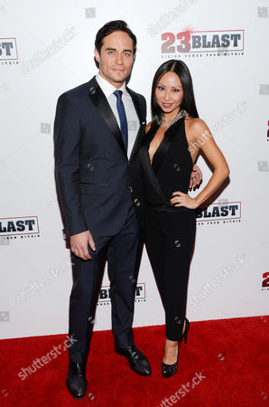 "Actor Bram Hoover and fiancee Diane Lim attend the premiere of ""23Blast"" at the Regal Cinemas E-Walk Theater on in New York"