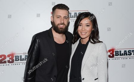 """Stock Picture of Producer Brent Ryan Green and his wife Trang Green attend the premiere of """"23Blast"""" at the Regal Cinemas E-Walk Theater on in New York"""