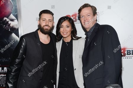 """Producer Brent Ryan Green, left, his wife Trang Green and director Dylan Baker attend the premiere of """"23Blast"""" at the Regal Cinemas E-Walk Theater on in New York"""
